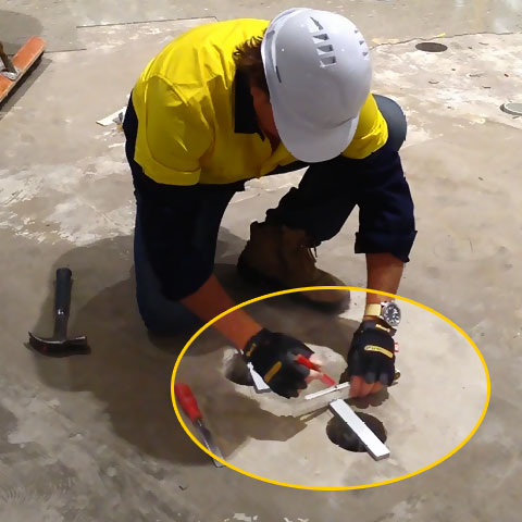 Mark a 10mm clearance around the flat bar on the slab